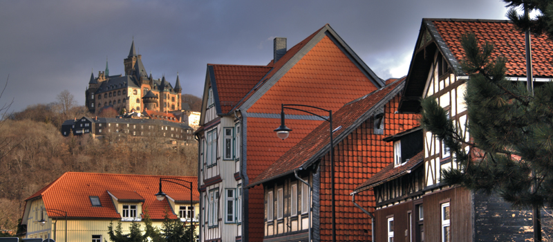 medieval castle on the hill and red roofed street in Wernigerode
